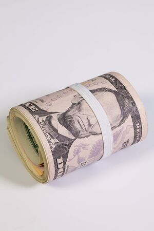Bribery - The roll of dollar bills with plastic band over the eyes