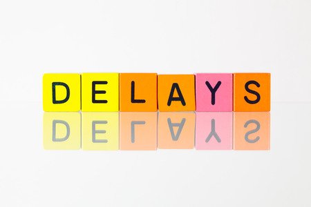 delays: Delays - an inscription from childrens wooden blocks Stock Photo