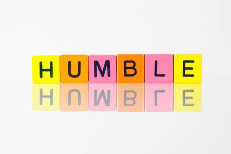 bashful: Humble - an inscription from childrens wooden blocks