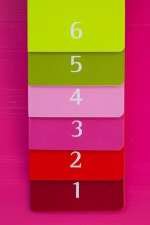 diaries: Six different color diaries on a pink wooden table