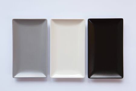 Different ceramic dishes on over white background, rectangle dish