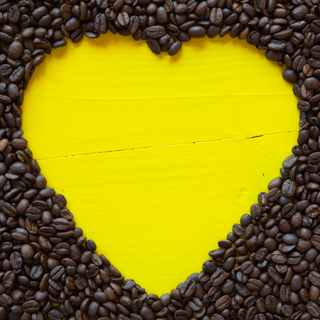 yellow heart: Big yellow heart from coffee beans