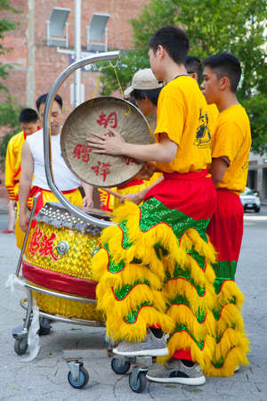 BOSTON, USA - JULY 2, 2016: Dragon dance - performers with the dragon costume.China Town in Boston is the only surviving historic ethnic Chinese area in New England