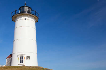 cod hole: Nobska Light, also known as Nobska Point Light is a lighthouse located in Woods Hole on the southwestern tip of Cape Cod, Massachusetts. Stock Photo
