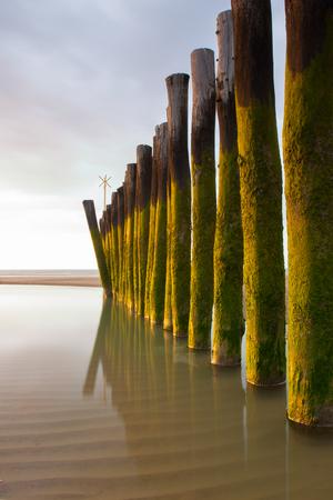 calais: Long exposure wooden breakwater photo. Calais, France Stock Photo
