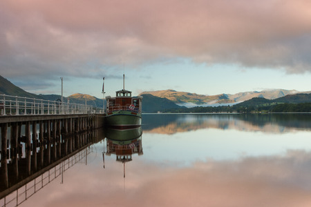 Steamboat docked on Ullswater in the Lake District in Cumbria ,England