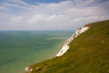 White chalk cliffs and aerial view of the Beachy Head Lighthouse, Eastbourne, East Sussex, England Stock Photo