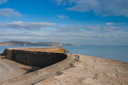 english channel: The Cobb harbour wall at Lyme Regis,Dorset .The town lies in Lyme Bay, on the English Channel coast at the Dorset Devon border