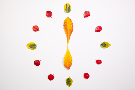 hands  hour: Autumn Time - Clock of autumn leafs Stock Photo