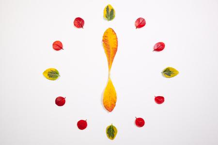 Autumn Time - Clock of autumn leafs Stock Photo