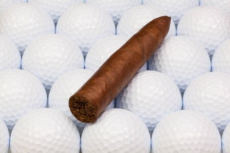 Detail of luxury Cuban cigars on the white golf balls