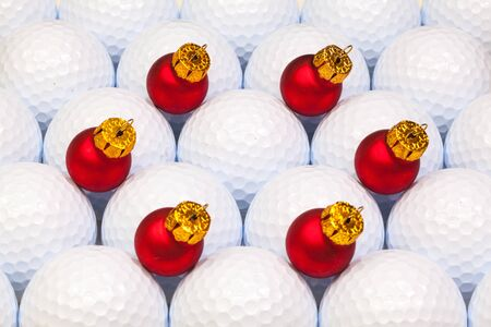 christmas golf: Red Christmas decoration between the white golf balls