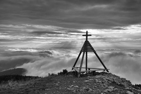 inversion: Wooden monument in Gerlitzen Apls,  Austria. Inverse  weather.