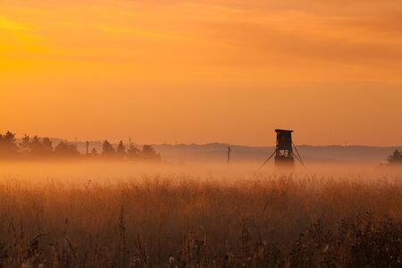 Hunting tower in the morning mist