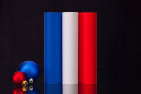 tricolour: French tricolour and Christmas decoration on the black glass table