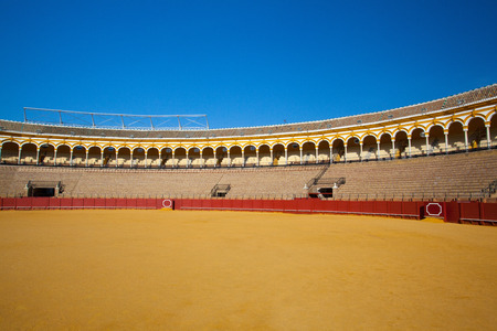 spanish bull: Seville, Spain - November 19,2016: Bullfight arena, plaza de toros at Sevilla.During the annual Seville Fair in Seville, it is the site of one of the most well known bullfighting festivals in the world. Editorial