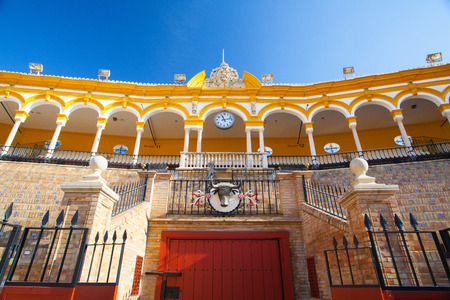 Seville, Spain - November 19,2016: Bullfight arena, plaza de toros at Sevilla.During the annual Seville Fair in Seville, it is the site of one of the most well known bullfighting festivals in the world. Editorial