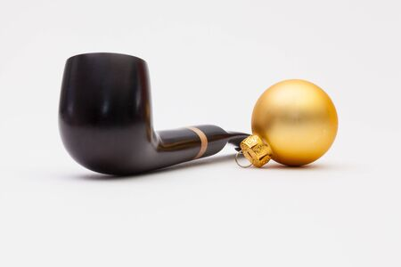 Luxury tobacco pipe and Christmas decoration on the white background