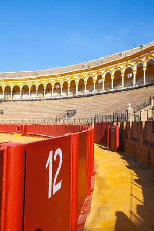 toros: Seville, Spain - November 19,2016: Bullfight arena, plaza de toros at Sevilla.During the annual Seville Fair in Seville, it is the site of one of the most well known bullfighting festivals in the world. Editorial