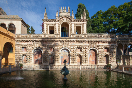 famous industries: Seville, Spain - November 18,2016: Real Alcazar Gardens in Seville.The Alcazar of Seville is a royal palace in Seville, Spain, originally developed by Moorish Muslim kings. Editorial