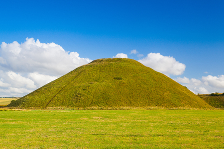 Silbury Hill, prehistoric artificial chalk mound near Avebury in the English county of Wiltshire Stock Photo