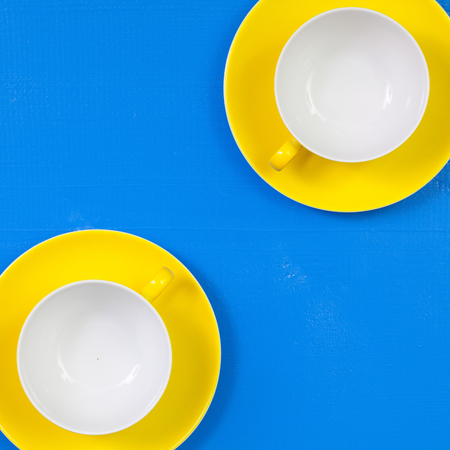 Symmetry  arrangement empty cups of tea on blue wooden table  - Flat lay image