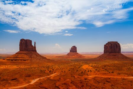 Iconic peaks of rock formations in the Navajo Park of Monument Valley in Utah
