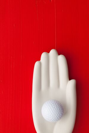 Detail of artifical hand with golf equipments  - Flat Lay Photography
