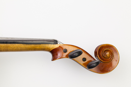 Top view close up shot of old violin on the white table. Flat Lay Image Stock Photo