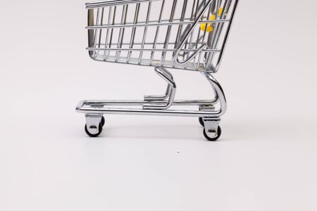 mart: Shopping trolley on the white background Stock Photo
