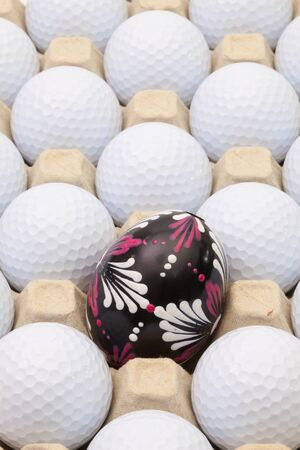 White golf balls in the box for eggs and Easter decoration 免版税图像