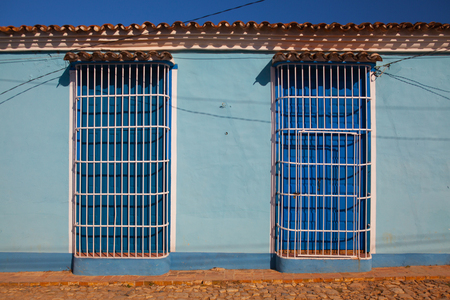 Typical colonial building with white window grate in Trinidad, Cuba