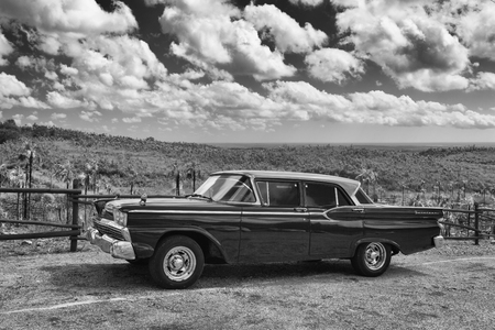pinar: Pinar del Rio, Cuba - January 29,2017: Old Ford Fairlane on the road in Valley de Vinales. Thousands of these cars are still in use in Cuba and they have become an iconic view and a worldwide known attraction