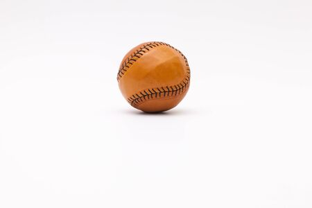Leather baseball ball on the white table
