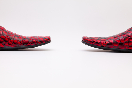 Detail of mens red shoes on white background