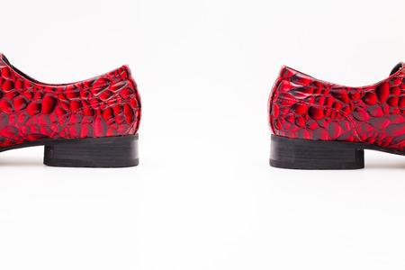 shoelace: Detail of mens red shoes on white background
