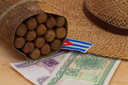 boater: Siesta - cigars, straw hat and Cuban banknotes on a wooden table Stock Photo