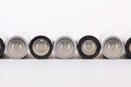 Energy abstract background of white and black batteries. AA size alkaline battery. Standard-Bild