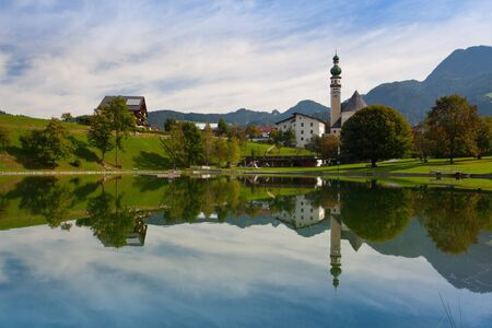 Reflection on the nature swimming pool in Reith, Alpbachtal in Tyrol, Austria