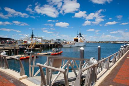 navy pier: Boston, Massachusetts, USA - July 7, 2016 : United States Coast Guard ships docked in Boston Harbor