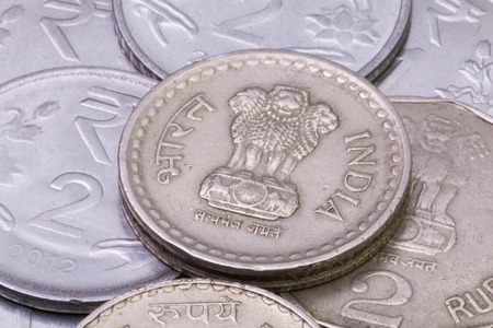 Detail of different India Rupees coins on the table.