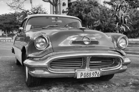 Trinidad, Cuba - January 22 ,2017: Old american car on the road Old Havana, Cuba.Thousands of these cars are still in use in Cuba and they have become an iconic view and a worldwide known attraction