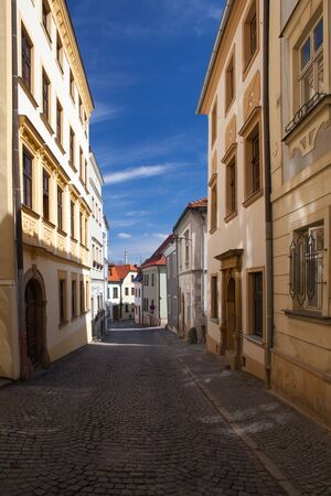 Empty street in Olomouc city in sunny day, Czech Republic. Famous UNESCO heritage city and tourist attraction.