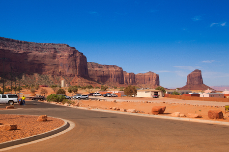 Utah, USA - July 7, 2011: Parking place and Peaks of rock formations in the Navajo Park of Monument Valley Utah Editorial
