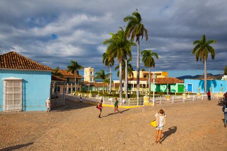 renovated: Trinidad, Cuba - January 30,2017: Plaza Mayor -Principal square of Trinidad. Typical colonial building with window wooden grate in Trinidad, Cuba.