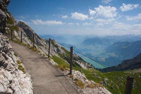 Panorama of the Upper Engadine from Muottas Muragl with very steep trail, Switzerland