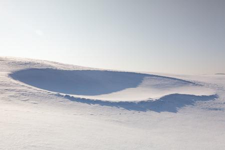 Golf bunker full of snow on the hill