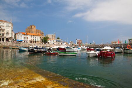 Castro Urdiales, Spain - July 9, 2017: Harbor in Castro Urdiales.It is  a seaport situated on the bay of Biscay and a modern town, although its castle and the Gothic style parish church of Santa María de la Asunción, date from the Middle Ages.