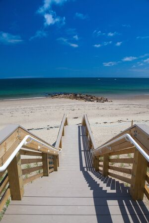 Famous walkway to the dunes.The walkway was destroyed by Hurricane Bob in 1991, but was rebuilt via private donations. In Sandwich, Cape Cod, Massachusetts, USA Archivio Fotografico