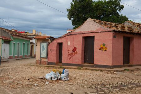 Trinidad, Cuba - January 30,2017: Typical colonial street in Trinidad.One of UNESCOs World Heritage sites since 1988. Due to embargo Cuba had problem with plenty of building material. Editorial